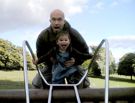 Natalie and Daddy playing on the slide